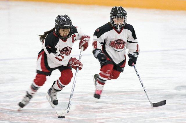 Female hockey players in season hockey training
