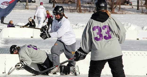 female hockey players body checking opponent.