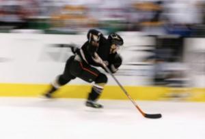 Image of hockey player skating.