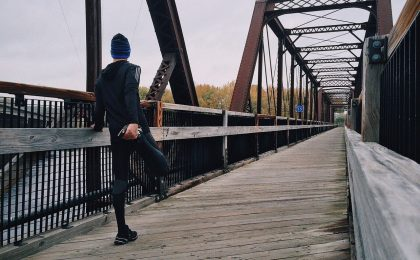 Athlete performing a hockey warm up on a bridge